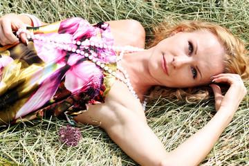 beautiful woman lays on hay