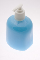 Bottle filled with blue liquid soap