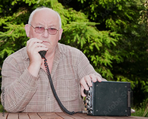 closeup image of senior making amateur radio 2way call