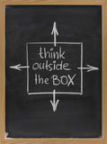 think outside the box phrase on blackboard poster