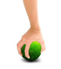human hand holding green planet tight