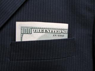hundred dollars banknote in pocket of black jacket