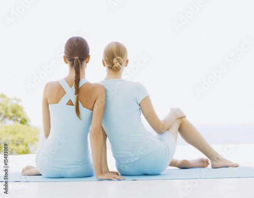 Rear view of two women outdoors