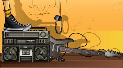 Boombox & guitar on the floor