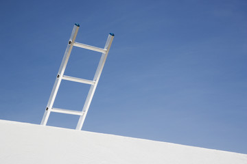 Wall with ladder and blue sky