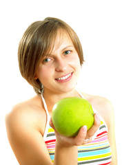 Smiling young lady with a green apple
