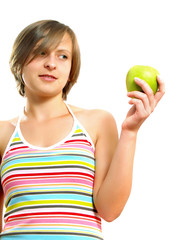 Attractive girl holding an apple