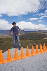 Man cornered by a row of safety cones