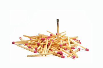 Pile of matches with one standing tall