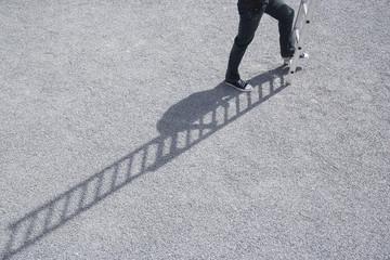 Man climbing ladder outdoors waist down