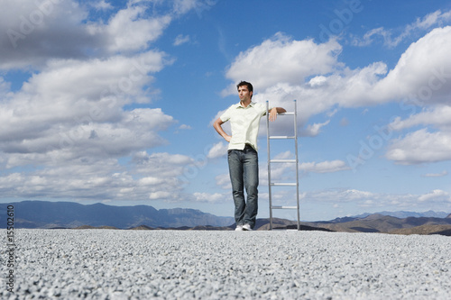 Man leaning on ladder outdoors