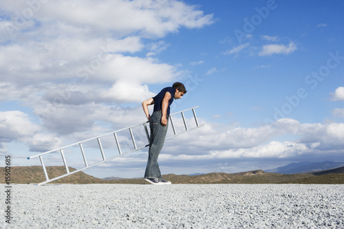 Man looking down with ladder