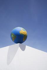 Globe outdoors on corner of wall