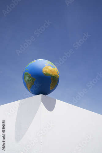 Globe outdoors on corner of wall