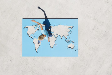 Aerial View of woman walking on world map outdoors