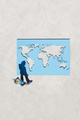 Aerial View of woman looking at world map outdoors