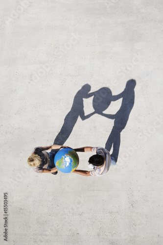 Aerial View of two people with shadow and globe