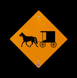 Horse and buggy sign with black background