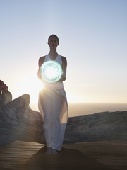 Woman holding an orb