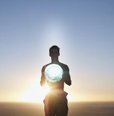 Man holding an orb