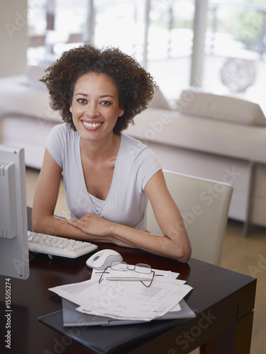 Woman seated at a desk with a computer