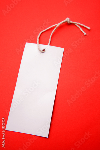 Tag and string on red background