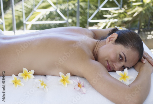 Woman relaxing with flowers around her