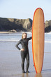 Woman holding a surfboard