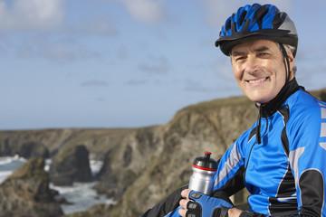 man in biking gear with a bottle of water