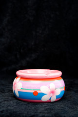 the colorful ashtray with flowers on black