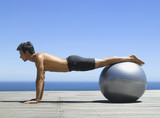 Man working out with an exercise ball