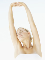 Woman stretching arms upward