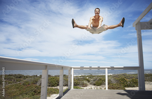A man jumping off the rail of a terrace