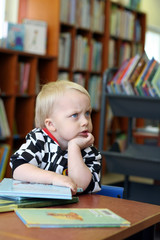 Thinking boy in the library
