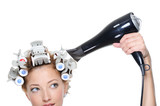 female with hairdryer drying hairs in hair-curled poster