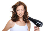 woman with fashion hairstyle holding hairdryer poster