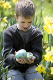 Young Boy Opening Easter Egg Looking Surpised