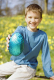 Young Boy Holding Easter Egg Smiling