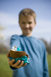 Young Boy Holding Chocolate Easter Egg