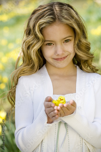 Young Girl Holding Easter Chicks Toys
