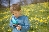 Young Boy Holding Easter Egg