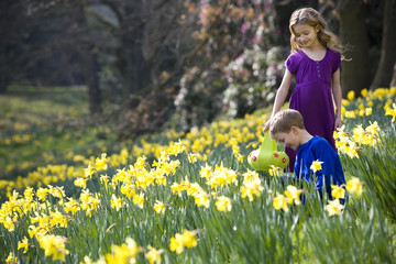 Girl and Boy Collecting Easter Eggs
