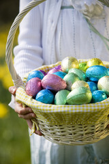 Young Girl Holding Basket Full of Easter Eggs
