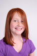 Pretty smiling redhead girl