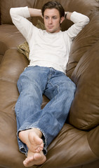 A young attractive man relaxing on the couch