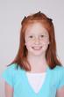 Pretty redhead smiling warmly