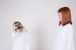 Two girls taking photographs