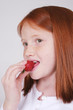 pretty girl eating a strawberry