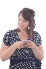 Young woman texting; isolated on a white background.