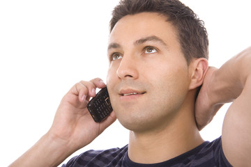 Young casual man using cellphone isolated on whithe